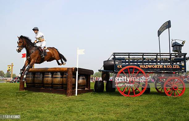 Harry Meade riding Wild Lone jumps over the Wadworth Barrels as they compete in the cross country stage during day three of the Badminton Horse...