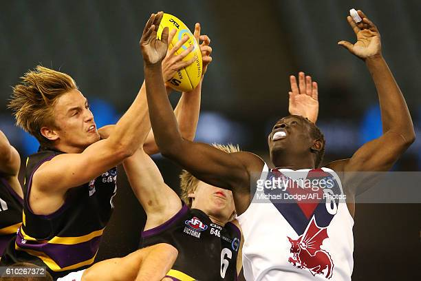 Harry Morrison of the Bushrangers and Goy Lok of the Dragons compete for the ball during the TAC Cup Grand Final match between the Murray Bushrangers...