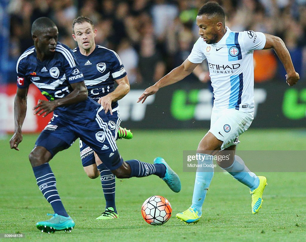 Harry Novillo of Melbourne City controls the ball against Jason Geria of the Victory during the round 19 A-League match between Melbourne City FC and Melbourne Victory at AAMI Park on February 13, 2016 in Melbourne, Australia.