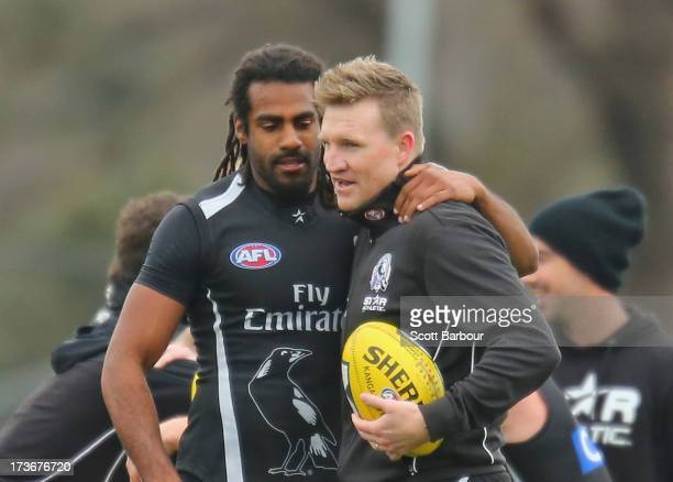 Harry O'Brien of the Magpies and Nathan Buckley the coach of the Magpies embrace during a Collingwood Magpies AFL training session at Olympic Park on...