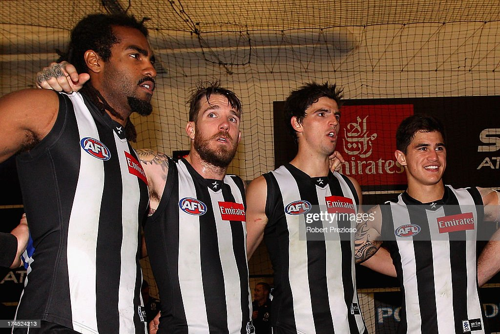 Harry O'Brien of the Magpies sings the club song after a win during the round 18 AFL match between the Collingwood Magpies and the Greater Western Sydney Giants at Melbourne Cricket Ground on July 27, 2013 in Melbourne, Australia.