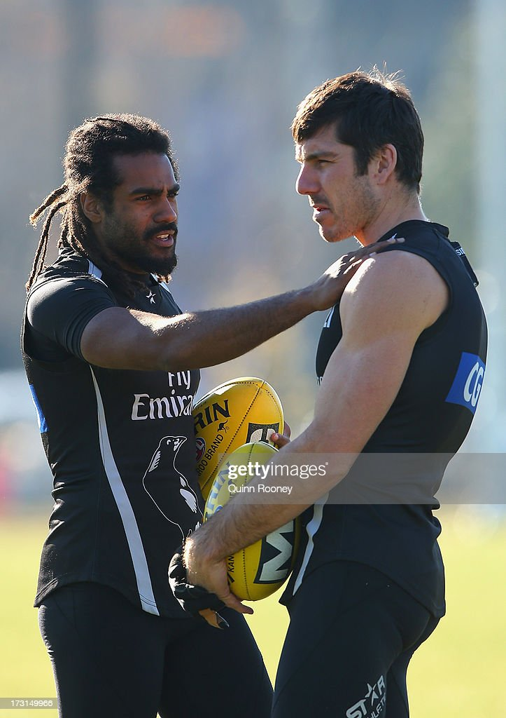Harry O'Brien of the Magpies talks to Quinten Lynch during a Collingwood Magpies AFL training session at Olympic Park on July 9, 2013 in Melbourne, Australia.