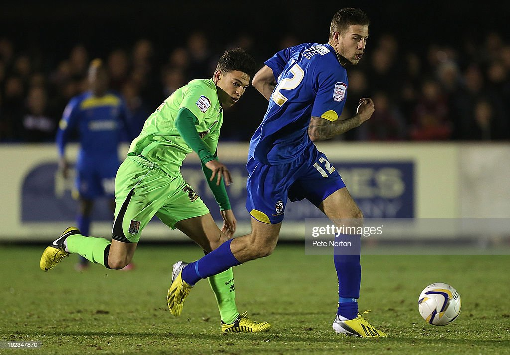 Harry Pell of AFC Wimbledon moves away with the ball from Lewis Hornby of Northampton Town during the npower League Two match between AFC Wimbledon and Northampton Town at The Cherry Red Records Stadium on February 19, 2013 in Kingston upon Thames, England.