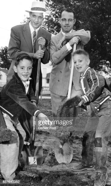 Harry Phillips of 1700 W Stole Pl and Jim Barnhard of 1710 W 50th Ave help out in the ground breaking for a new educational wing at the Chaffee...