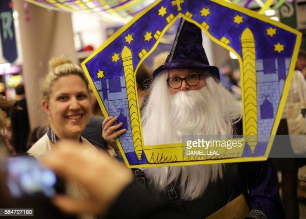 A Harry Potter fan dressed as a character from the Harry Potter books poses for a photograph inside Waterstones bookshop on Piccadilly in central...
