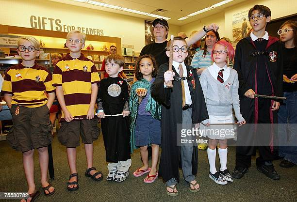 Harry Potter fans participate in a costume contest during a book release party for 'Harry Potter and the Deathly Hallows' at a Barnes Noble...