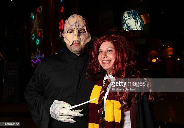 Harry Potter fans pose in costume ahead of the first public screening of the final Harry Potter film 'Harry Potter and the Deathly Hallows Part 2' at...