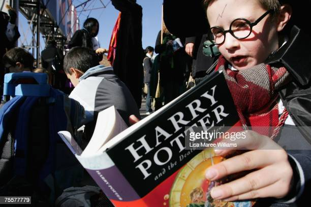 Harry Potter fans rush to read the opening lines of the new and final novel by author JK Rowling 'Harry Potter and the Deathly Hallows' during a fans...