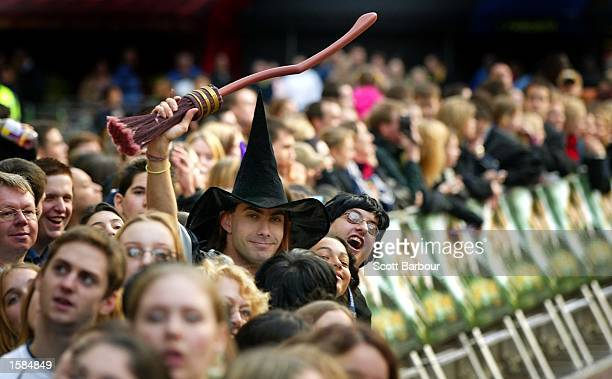 Harry Potter fans wait for the stars to arrive at the Harry Potter and the Chamber of Secrets world premiere November 3 2002 in London England The...