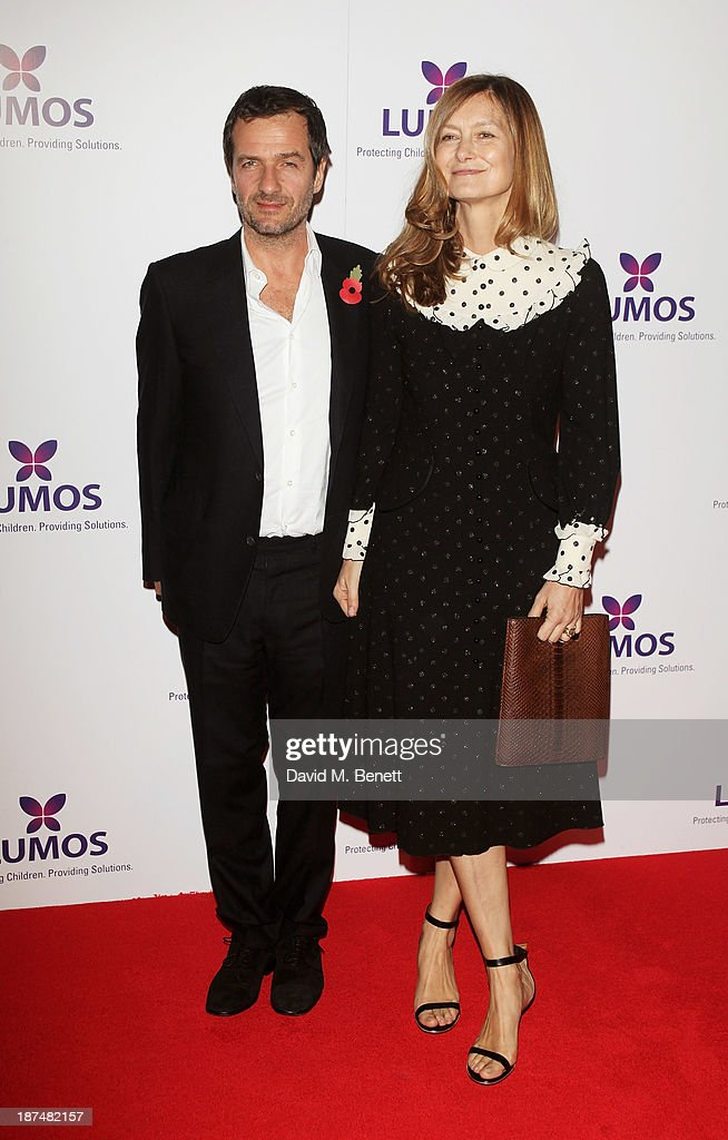 Harry Potter producer David Heyman (L) and wife Rose Uniacke attend the Lumos fundraising event hosted by J.K. Rowling at The Warner Bros. Harry Potter Tour on November 9, 2013 in London, England.