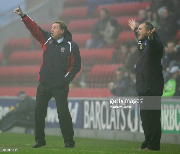 Harry Redknapp manager of Portsmouth and Paul Jewell manager of Wigan Athletic give out instructions during the Barclays Premiership match between...