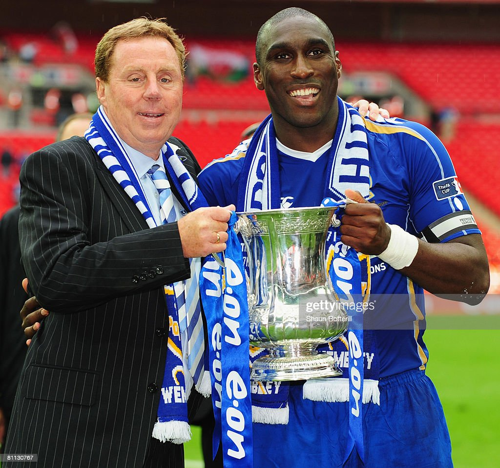 Harry Redknapp manager of Portsmouth lifts the trophy with Sol Campbell following the FA Cup Final sponsored by EON between Portsmouth and Cardiff...