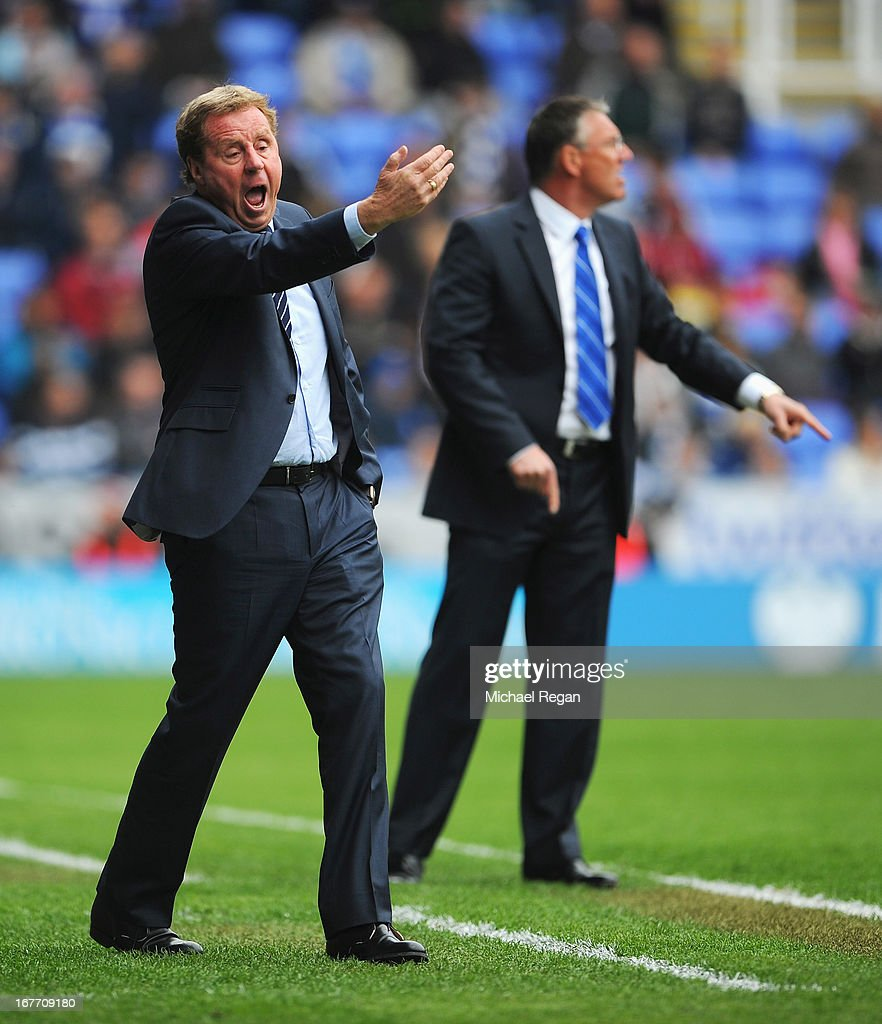 Harry Redknapp, manager of Queens Park Rangers gives instructions with Nigel Adkins, manager of Reading during the Barclays Premier League match between Reading and Queens Park Rangers at the Madejski Stadium on April 28, 2013 in Reading, England.