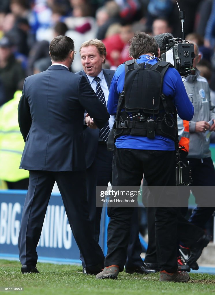 Harry Redknapp, manager of Queens Park Rangers shakes hands with Nigel Adkins, manager of Reading after their teams were relegated during the Barclays Premier League match between Reading and Queens Park Rangers at the Madejski Stadium on April 28, 2013 in Reading, England.