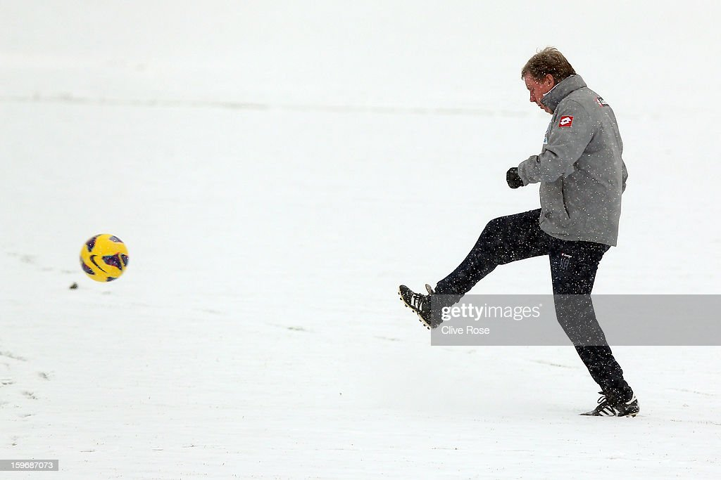 Harry Redknapp of Queens Park Rangers kicks a ball during a training session on January 18, 2013 in Harlington, England.