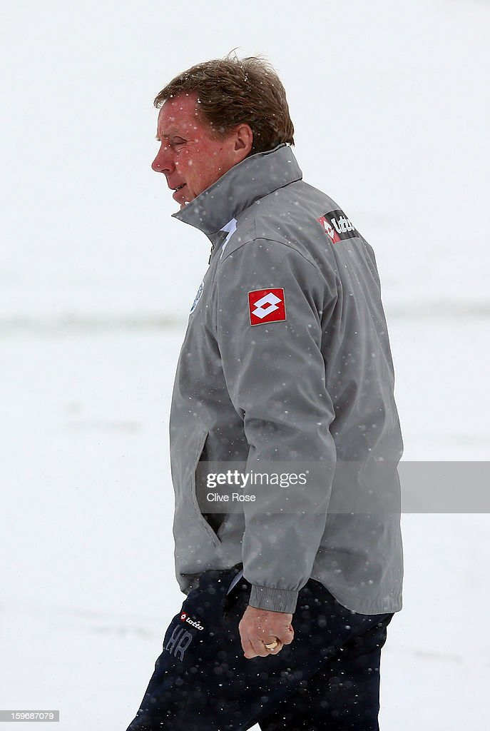 <a gi-track='captionPersonalityLinkClicked' href=/galleries/search?phrase=Harry+Redknapp&family=editorial&specificpeople=204768 ng-click='$event.stopPropagation()'>Harry Redknapp</a> of Queens Park Rangers looks on during a training session on January 18, 2013 in Harlington, England.