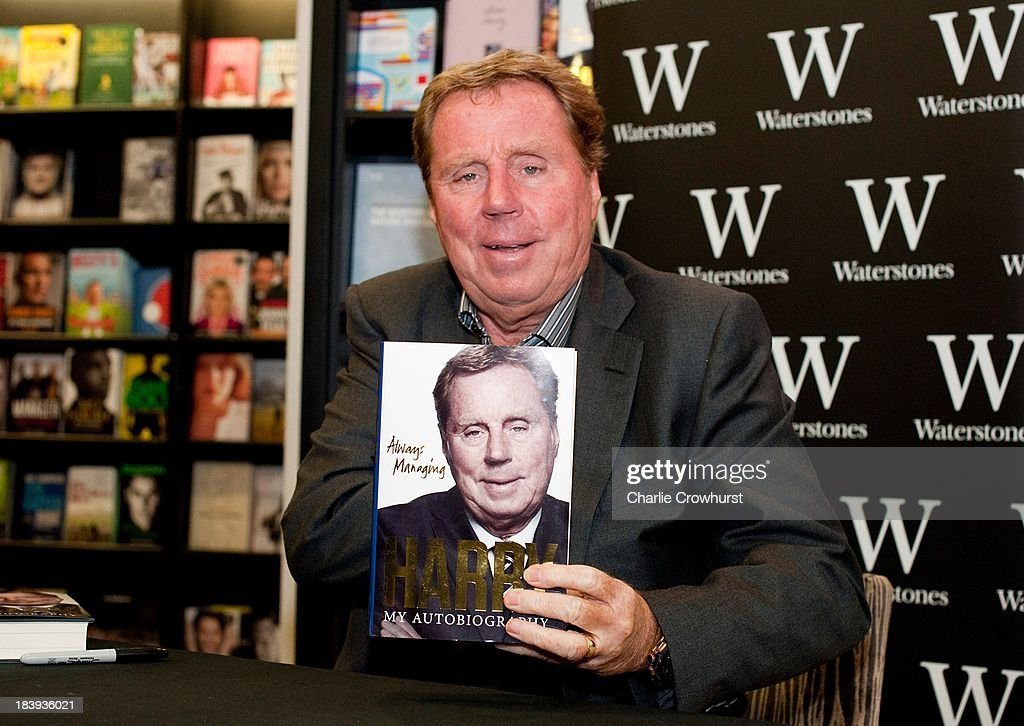 Harry Redknapp poses with a copy of his autobiography 'Always Managing' during the book signing session at Waterstone's on October 10, 2013 in London, England.
