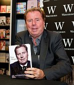 Harry Redknapp poses with a copy of his autobiography 'Always Managing' during the Harry Redknapp Book Signing at Waterstone's on October 10 2013 in...