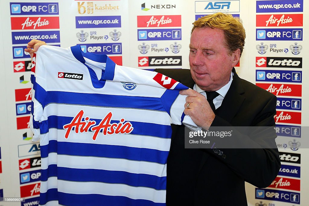Harry Redknapp poses with the team shirt after being unveiled as the new Queens Park Rangers Manager on November 26, 2012 in Harlington, England.