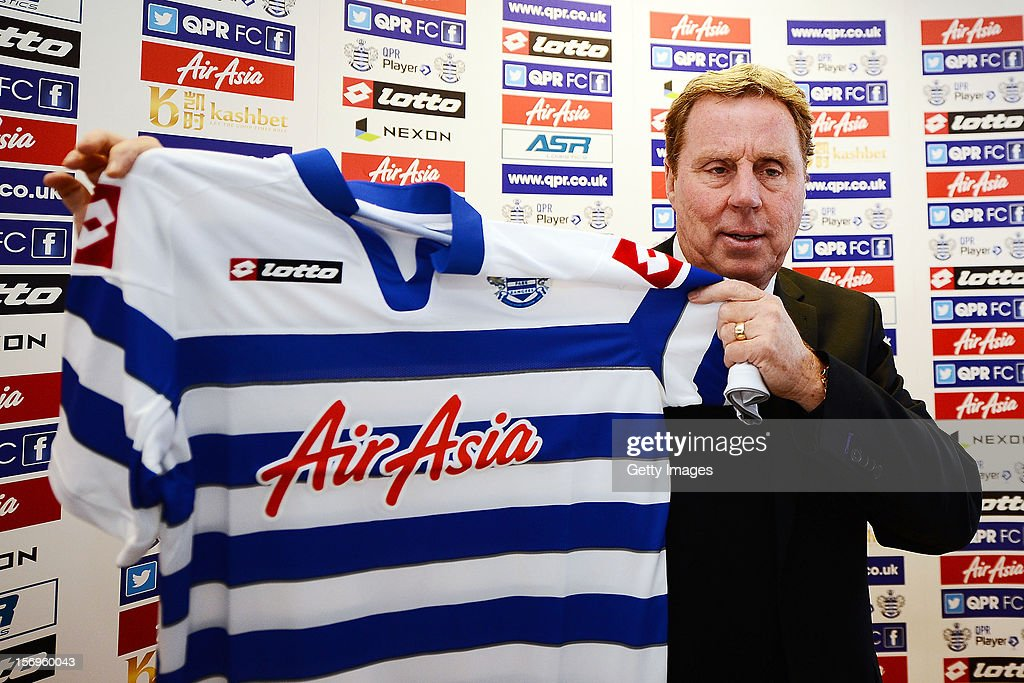 <a gi-track='captionPersonalityLinkClicked' href=/galleries/search?phrase=Harry+Redknapp&family=editorial&specificpeople=204768 ng-click='$event.stopPropagation()'>Harry Redknapp</a> poses with the team shirt after being unveiled as the new Queens Park Rangers Manager on November 26, 2012 in Harlington, England.