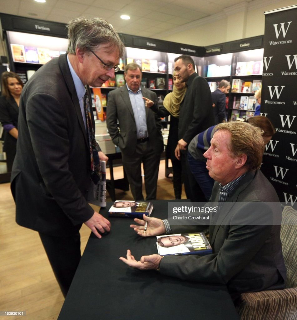 <a gi-track='captionPersonalityLinkClicked' href=/galleries/search?phrase=Harry+Redknapp&family=editorial&specificpeople=204768 ng-click='$event.stopPropagation()'>Harry Redknapp</a> speaks with a member of the public as he sign's copies of his autobiography 'Always Managing' at Waterstone's on October 10, 2013 in London, England.