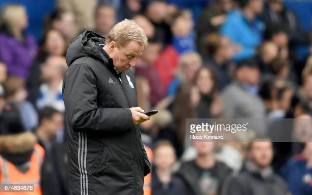 Harry Redknapp the manager of Birmingham City cehcks his mobile phone after the Sky Bet Championship match between Birmingham City and Huddersfield...