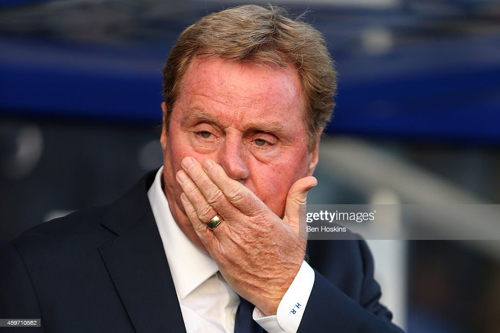 Harry Redknapp the QPR manager looks on before the Barclays Premier League match between Queens Park Rangers and Leicester City at Loftus Road on November 29, 2014 in London, England.
