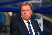 Harry Redknapp the QPR manager looks on before the Barclays Premier League match between Queens Park Rangers and Leicester City at Loftus Road on...