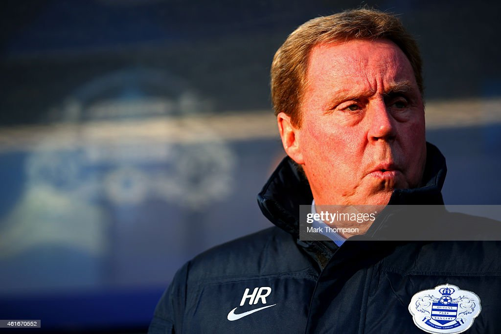 Harry Redknapp the QPR manager looks on before the Barclays Premier League match between Queens Park Rangers and Manchester United at Loftus Road on January 17, 2015 in London, England.