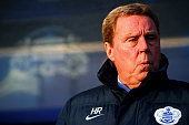 Harry Redknapp the QPR manager looks on before the Barclays Premier League match between Queens Park Rangers and Manchester United at Loftus Road on...