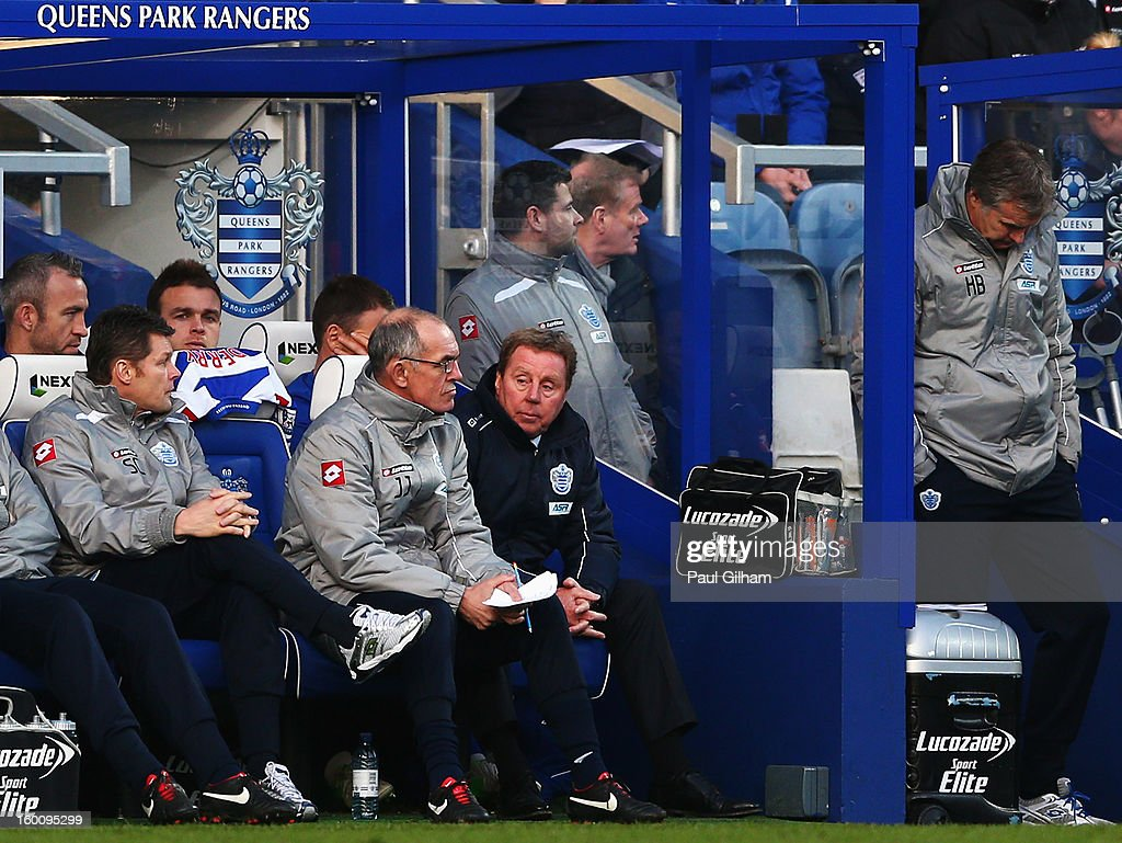 Harry Redknapp the Queens Park Rangers manager and his first team coach Joe Jordan react on the touchline during the FA Cup with Budweiser Fourth Round match between Queens Park Rangers and Milton Keynes Dons at Loftus Road on January 26, 2013 in London, England.