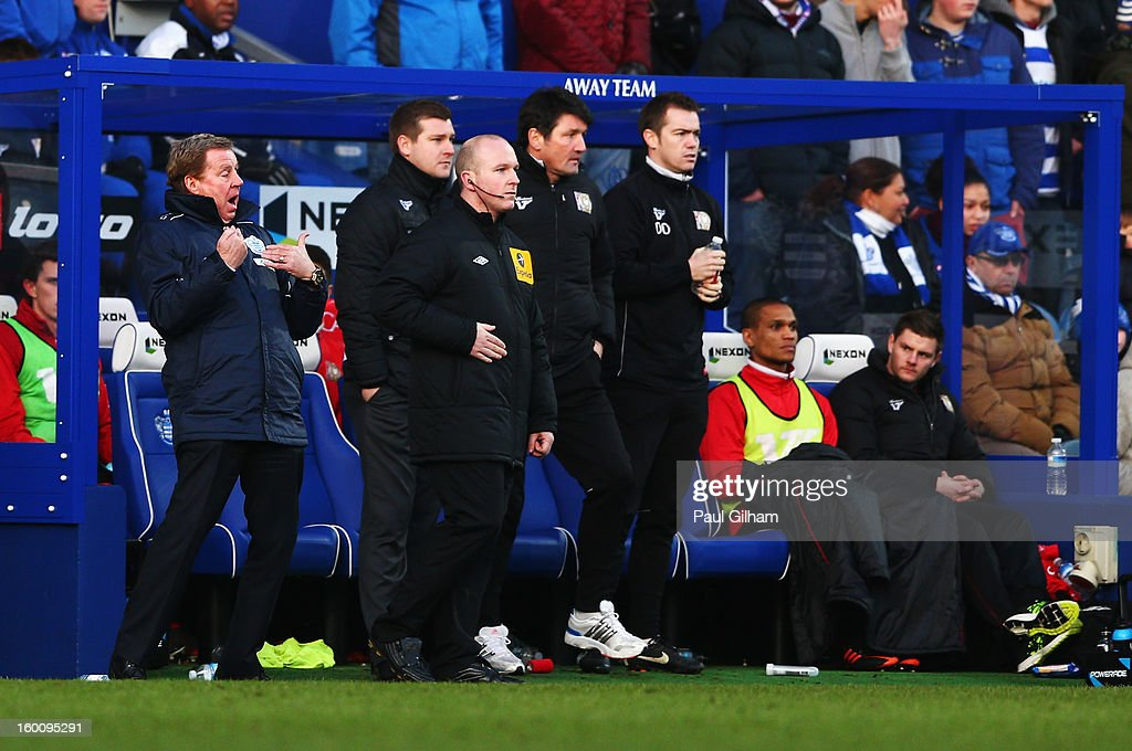 Harry Redknapp (L) the Queens Park Rangers manager reacts on the touchline during the FA Cup with Budweiser Fourth Round match between Queens Park Rangers and Milton Keynes Dons at Loftus Road on January 26, 2013 in London, England.