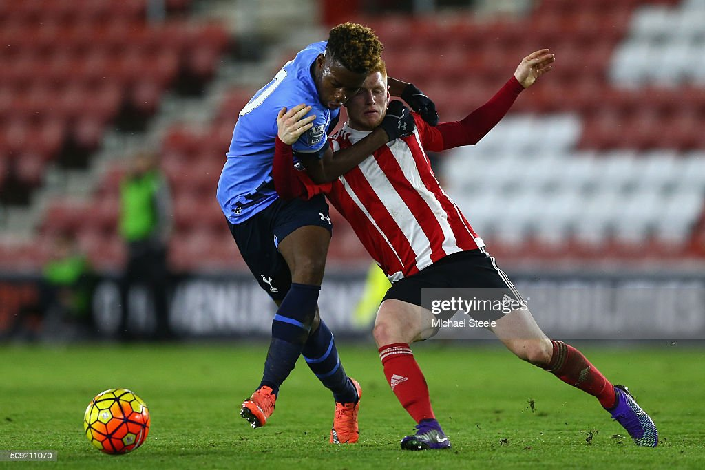 Harry Reed of Southampton U21 grapples with Josh Onomah of Tottenham Hotspur U21 during the Barclays U21 Premier League match between Southampton and Tottenham Hotspur at St Mary's Stadium on February 9, 2016 in Southampton, England.