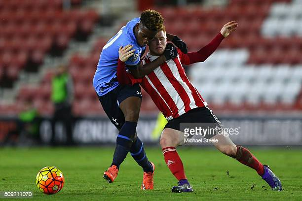 Harry Reed of Southampton U21 grapples with Josh Onomah of Tottenham Hotspur U21 during the Barclays U21 Premier League match between Southampton and...