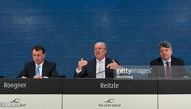Harry Roegner communications officer for Linde AG left and Georg Denoke chief financial officer of Linde AG right listen as Wolfgang Reitzle chief...