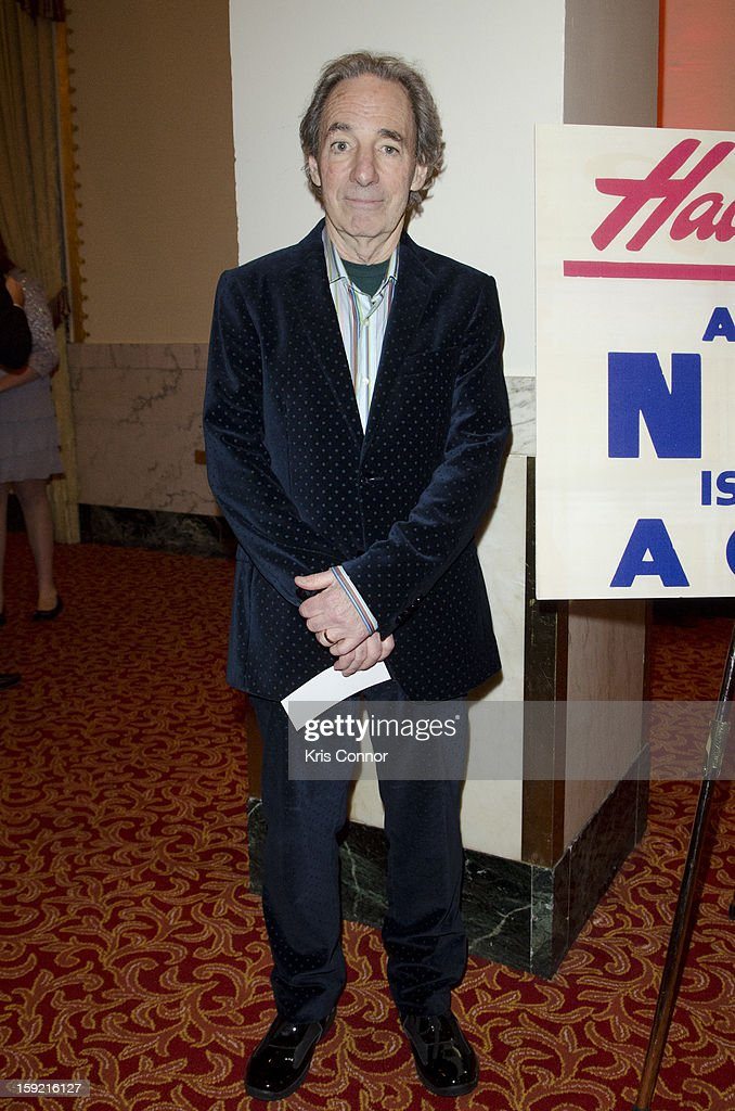 <a gi-track='captionPersonalityLinkClicked' href=/galleries/search?phrase=Harry+Shearer&family=editorial&specificpeople=693381 ng-click='$event.stopPropagation()'>Harry Shearer</a> poses for a photo during President Nixon's 100th Birthday Gala on January 9, 2013 in Washington, United States.