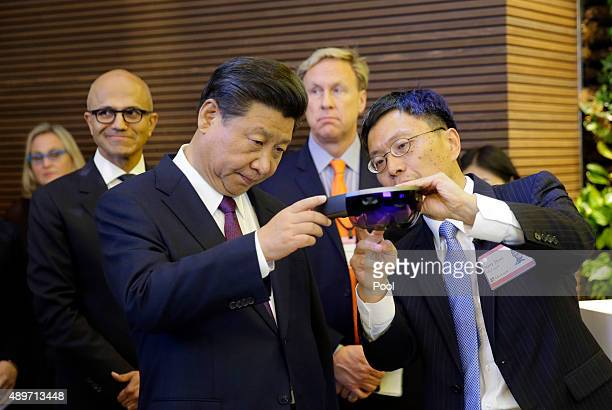 Harry Shum Microsoft executive vice president of technology and research demonstrates Micosoft's HoloLens device to Chinese President Xi Jinping...