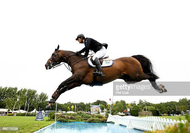 Harry Smolders of Ireland ridding JE T'Aime Flamenco going over the water jump during the Longines King George V Gold Cup at the Longines...