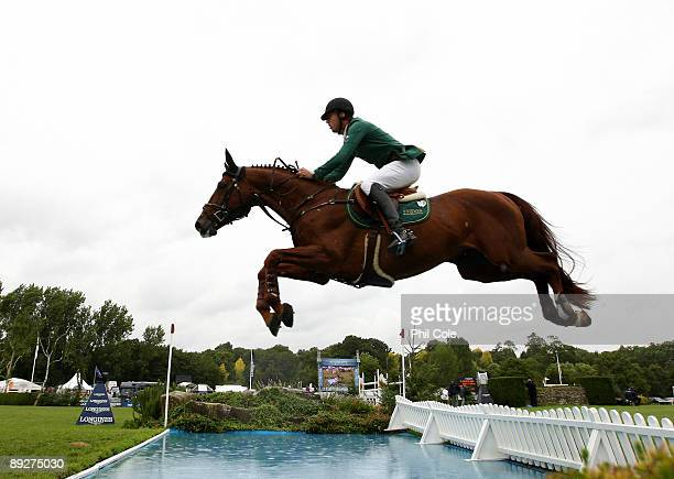 Harry Smolders of the Netherlands ridding Exquis Oliver Q going over the water jump during the Longines King George V Gold Cup at the Longines...