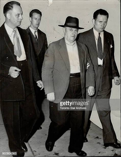 Harry Springall 66 doorman of the Alexandra Palace is led from the swank private hotel after his arrest on a charge of mudering Alexander Douglas...