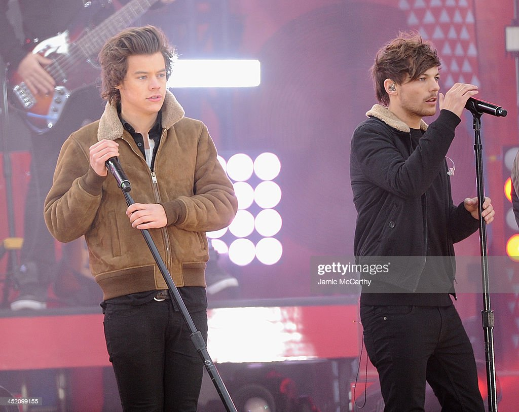 Harry Styles and Louis Tomlinson of One Direction perform at Rumsey Playfield on November 26, 2013 in New York City.
