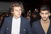 Harry Styles and Zayn Malik of One Direction attend the 15th NRJ Music Awards at Palais des Festivals on December 14 2013 in Cannes France