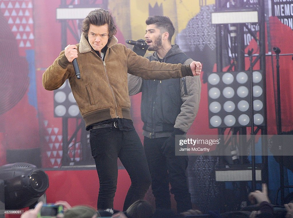 Harry Styles and Zayn Malik of One Direction perform at Rumsey Playfield on November 26, 2013 in New York City.