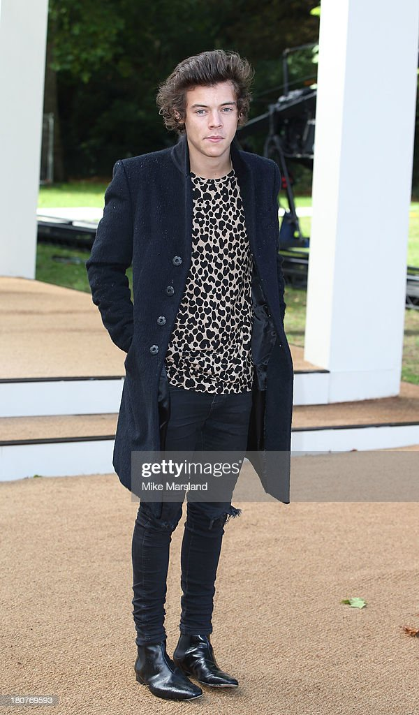 Harry Styles attends the Burberry Prorsum show during London Fashion Week SS14 at Kensington Gardens on September 16, 2013 in London, England.