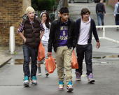 Harry Styles Cher Lloyd Zain Malik and Niall Horan sighted getting some snacks before returning to a recording studio on October 4 2010 in London...