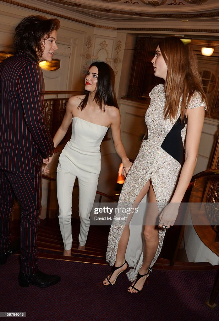 Harry Styles Kendall Jenner and Model of the Year winner Cara Delevingne attend the British Fashion Awards at the London Coliseum on December 1 2014...