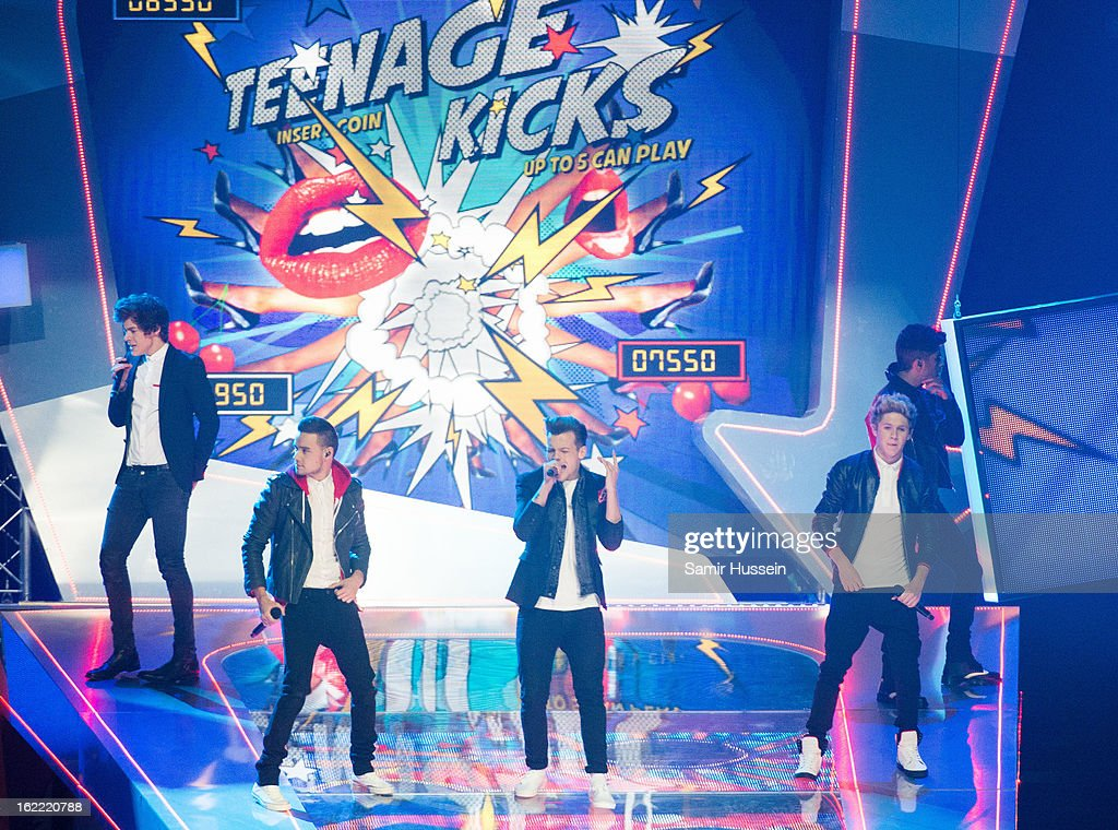 Harry Styles, Liam Payne, Louis Tomlinson, Niall Horan and Zayn Malik of One Direction perform during the Brit Awards 2013 at 02 Arena on February 20, 2013 in London, England.