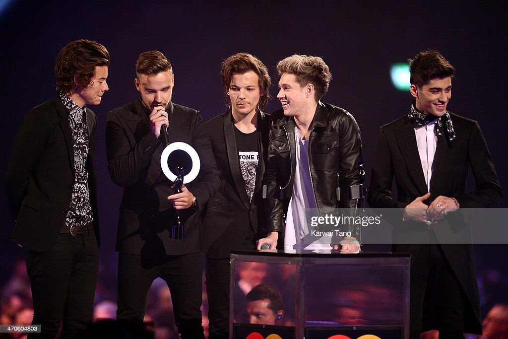 Harry Styles, Liam Payne, Louis Tomlinson, Niall Horan and Zayn Malik from One Direction receive the award for Best Video at the BRIT Awards 2014 at 02 Arena on February 19, 2014 in London, England.