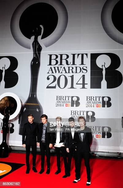 Harry Styles Liam Payne Nial Horan Louis Tomlinson and Zayn Malik from One Direction arriving for the 2014 Brit Awards at the O2 Arena London
