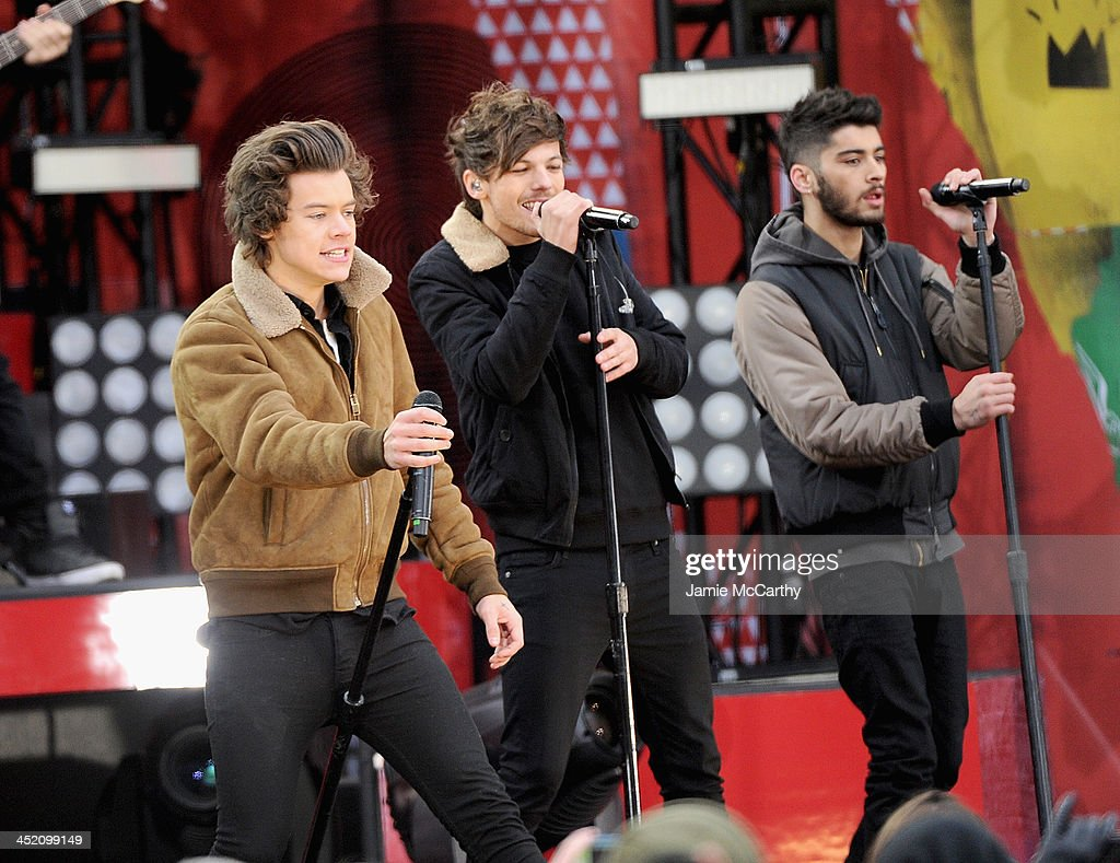 Harry Styles, Louis Tomlinson and Zayn Malik of One Direction perform at Rumsey Playfield on November 26, 2013 in New York City.